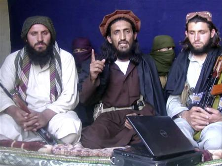 In this image taken from a video recording, Pakistan Taliban commander, gives an interview in Pakistan's Mohmand tribal region